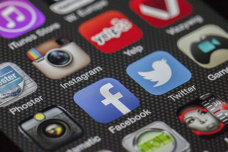Facebook and Social Media icons on phone screen