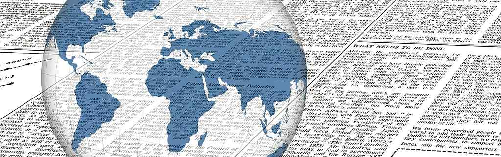 newspaper clips with world globe