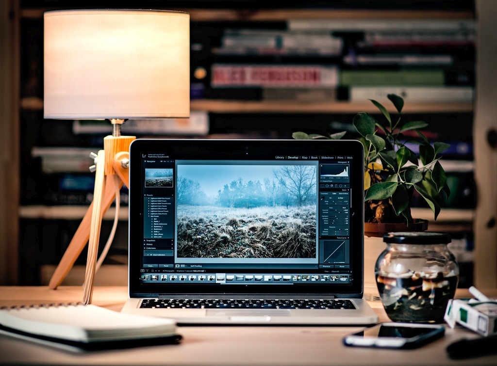 laptop on desk displays image