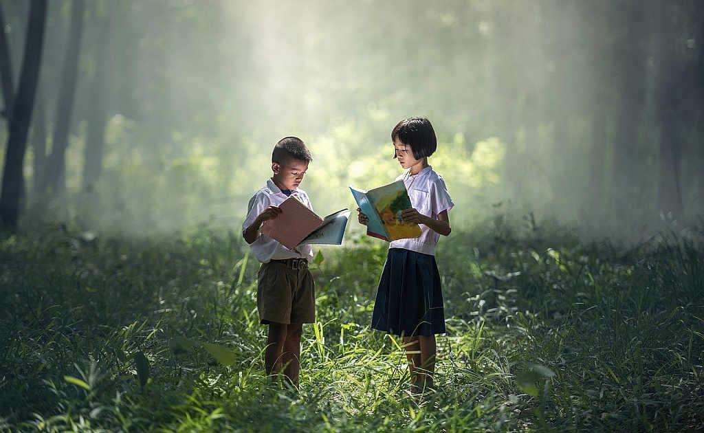 asian children read books countryside field